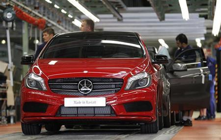 Employees of German car manufacturer Mercedes Benz make final touches to Mercedes A-class cars at the Mercedes plant in Rastatt July 16, 2012. REUTERS/Alex Domanski