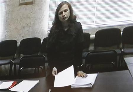 Jailed Pussy Riot punk rock group member Maria Alyokhina is pictured on a monitor, as she takes part in a video conference from the penal colony, inside the courtroom during a hearing in the town of Berezniki May 22, 2013. REUTERS/Maxim Shemetov