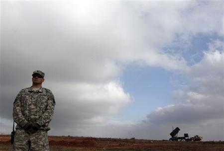 A U.S. soldier stands guard near a U.S. Patriot missile system at a Turkish military base in Gaziantep February 5, 2013. REUTERS/Osman Orsal