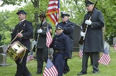 Jim Smith (L) of Hempfield, leads members of the Grand Army of the Republic Post 88, Pittsburgh, and the Armbrust Veterans and Civil War Re-enactors for a ceremony at the graveside of Peter Guibert, a Union Civil War drummer boy in Pittsburgh, Pennsylvania, May 24, 2013. REUTERS/Jeffrey B. Roth
