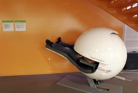 An employee takes a nap in a nap pod which blocks out light and sound at the Google headquarters in Mountain View, California March 3, 2008. REUTERS/Erin Siegal/Files