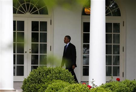 U.S. President Barack Obama walks towards the Oval Office at the White House in Washington, May 28, 2013. REUTERS/Larry Downing