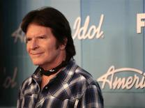 "Singer John Fogerty poses in the backroom after performing at the 11th season finale of ""American Idol"" in Los Angeles, California, May 23, 2012. REUTERS/Jason Redmond"