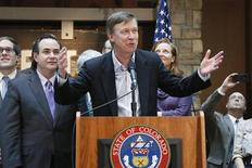 Colorado Governor John Hickenlooper (C) speaks before he signs into law the civil unions act in Denver March 21, 2013. REUTERS/Rick Wilking