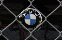 A BMW luxury car logo is pictured behind a fence at a BMW garage in Niderwangen near Bern, May 24, 2012. REUTERS/Pascal Lauener