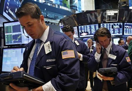 Traders work on the floor at the New York Stock Exchange, May 28, 2013. REUTERS/Brendan McDermid