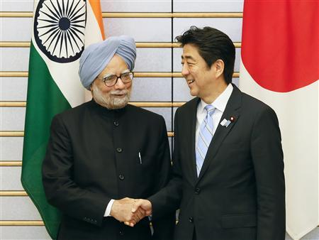 India's Prime Minister Manmohan Singh (L) shakes hands with his Japanese counterpart Shinzo Abe at the start of talks at Abe's official residence in Tokyo May 29, 2013. REUTERS/Kimimasa Mayama/Pool