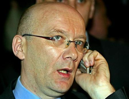 Bosnian Croat war time leader Jadranko Prlic, who is also a Croatian citizen, talks on a phone before departing for [The Hague] from Zagreb airport April 5, 2004.