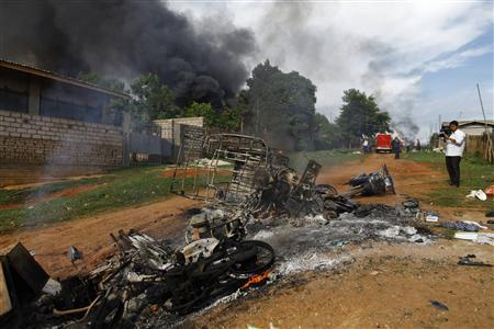 Motorcycles and houses destroyed in a fire after a riot between Muslims and Buddhist are seen in Lashio township May 29, 2013. REUTERS-Soe Zeya Tun