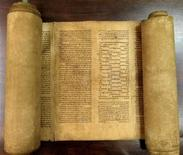 A scroll identified by Italian professor Mauro Perani as the world's oldest complete scroll of the Torah is seen in Bologna, central Italy, in this handout picture released to Reuters by Mauro Perani on May 29, 2013. Perani, professor of Hebrew at the University of Bologna, said on Wednesday he has identified the world's oldest complete scroll of the Torah containing the full text of the first five books of scripture. He said experts and carbon dating tests done in Italy and United States put the scroll as having been written between 1155 and 1255. REUTERS/Mauro Perani/Handout via Reuters