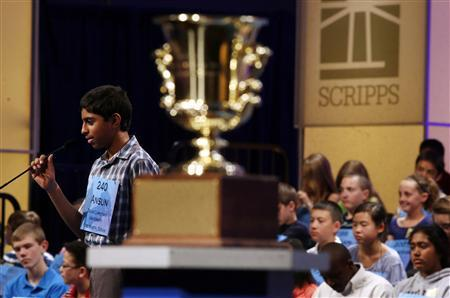 Ansun Sujoe, of Fort Worth, spells a word correctly behind the winner's trophy during the 2013 Scripps National Spelling Bee at the Gaylord National Resort and Convention Center at National Harbor in Maryland, May 29, 2013. REUTERS-Larry Downing