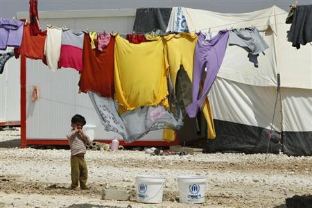 A Syrian refugee boy stand outside his family's tent at Al Zaatri refugee camp in the Jordanian city of Mafraq, near the border with Syria, April 30, 2013. REUTERS/ Majed Jaber