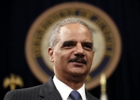 U.S. Attorney General Eric Holder looks on during a special naturalization ceremony at the Department of Justice in Washington May 28, 2013. REUTERS/Kevin Lamarque
