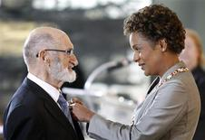 Henry Morgentaler (L) is awarded the rank of Member in the Order of Canada by Governor General Michaelle Jean at the Citadelle in Quebec City, in this October 10, 2008 file photo. REUTERS/Mathieu Belanger/Files