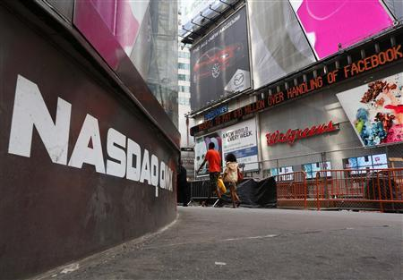The Nasdaq logo is seen on the exterior of the Nasdaq MarketSite as a headline about a penalty paid over the Facebook stock scrolls on the Times Square Newsticker, in New York, May 29, 2013. REUTERS/Brendan McDermid