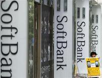 A clerk works in front of a SoftBank Corp branch in Tokyo May 29, 2013. REUTERS/Toru Hanai