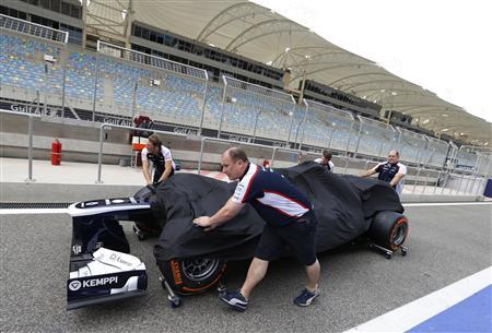 Williams Formula One mechanics push one of their team's car to the scrutineering area at the Bahrain International Circuit April 18, 2013. REUTERS/Hamad I Mohammed