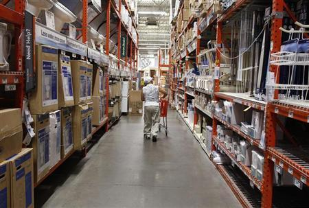A man pushes his shopping cart down an aisle at a Home Depot store in New York, July 29, 2010.REUTERS/Shannon Stapleton