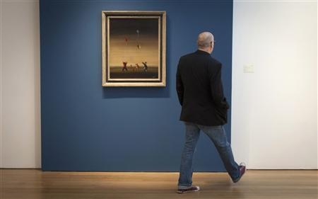 A man walks past Brazilian Candido Portinari's ''Children Releasing Kites'' at Christie's Auction House in New York, May 27, 2013. The painting is expected to fetch up to $1.2 million at Christie's Latin American art auction on May 29. REUTERS/Carlo Allegri