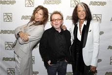 Steven Tyler (L) and Joe Perry (R) of the group Aerosmith pose with ASCAP president Paul Williams during a photo opportunity in Los Angeles April 8, 2103. REUTERS/Fred Prouser