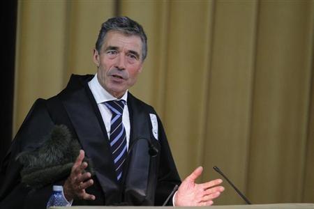 NATO Secretary General Anders Fogh Rasmussen delivers an acceptance speech after being awarded a Doctor Honoris Causa degree from Bucharest University in Bucharest May 24, 2013. REUTERS/Bogdan Cristel