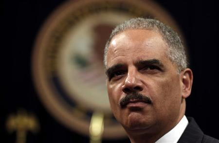 U.S. Attorney General Eric Holder looks out during a special naturalization ceremony at the Department of Justice in Washington May 28, 2013. REUTERS/Kevin Lamarque