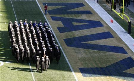 Midshipmen from the United States Naval Academy before the start of an Army versus Navy football game in Philadelphia, December 12, 2009. REUTERS/Molly Riley