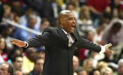 Atlanta Hawks head coach Larry Drew makes a call in the first half of their first-round Eastern Conference playoff NBA basketball game against the Indiana Pacers in Atlanta, Georgia May 3, 2013. REUTERS/Tami Chappell