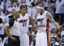 Miami Heat's Chris Andersen (R) discusses a foul with an official as teammate Shane Battier listens in during the second quarter in Game 5 of their NBA Eastern Conference final basketball playoff in Miami, Florida May 30, 2013. REUTERS/Joe Skipper