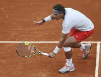 Rafael Nadal of Spain hits a return to Martin Klizan of Slovakia during their men's singles match at the French Open tennis tournament at the Roland Garros stadium in Paris May 31, 2013. REUTERS/Stephane Mahe