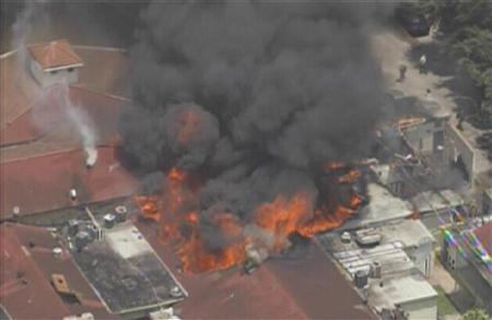 A five-alarm fire burns at a hotel in southwest Houston, Texas, May 31, 2013 in this image taken from video courtesy of KPRC-Local2. At least six firefighters were injured, two of them very critically, battling a five-alarm fire at a restaurant and hotel in southwest Houston Friday afternoon, the Houston Fire Department said. REUTERS-KPRC-Local2-Handout via Reuters