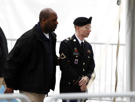 U.S. Army Private First Class Bradley Manning (R) arrives at the courthouse for a motion hearing at Fort Meade in Maryland, May 21, 2013. REUTERS/Jose Luis Magana