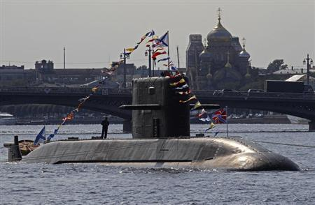 A Russian submarine is anchored on the Neva River in central part of the city of St. Petersburg, July 27, 2012. REUTERS/Alexander Demianchuk