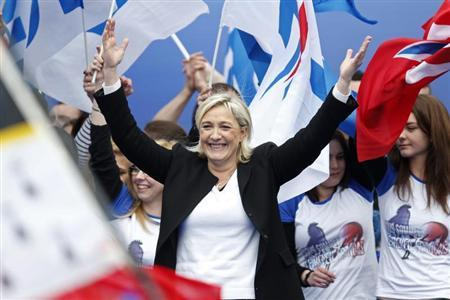Marine Le Pen, France's National Front political party leader, reacts as she attends their traditional rally in Paris May 1, 2013. REUTERS/Charles Platiau