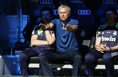 Real Madrid coach Jose Mourinho reacts during their Spanish first division soccer match against Osasuna at Santiago Bernabeu stadium in Madrid June 1, 2013. REUTERS/Javier Barbancho
