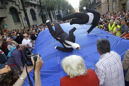 Dummies symbolizing the ''Troika'' are tossed in the air by demonstrators during a protest against austerity measures imposed by the ''Troika'' in Valencia, June 1, 2013. REUTERS/Heino Kalis