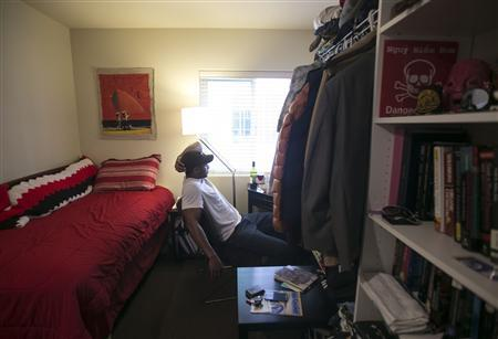 Jon-Christian Stubblefield relaxes inside of his 200 square foot Mini-Suite apartment in the First Hill neighborhood in Seattle, Washington May 12, 2013. REUTERS/Nick Adams