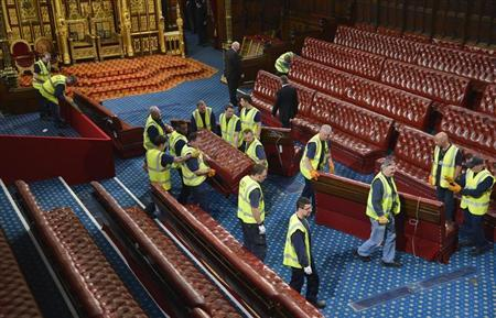 Workmen move the seats in the House of Lords before the State Opening of Parliament, at the Palace of Westminster, in London May 8, 2013. REUTERS/Toby Melville
