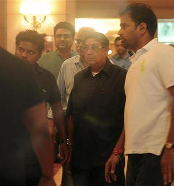 BCCI president N. Srinivasan (2nd R) walks out after attending a working committee meeting in Chennai June 2, 2013. REUTERS/Stringer