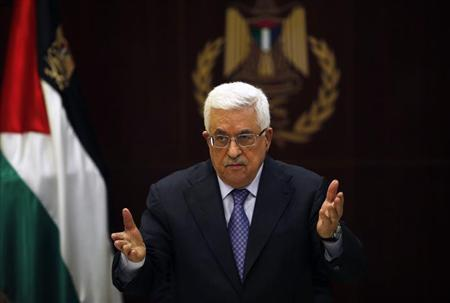 Palestinian President Mahmoud Abbas gestures during a Palestinian Liberation Organization (PLO) executive committee meeting in the West Bank city of Ramallah May 28, 2013. REUTERS/Mohamad Torokman