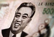 North Korean leader Kim Il-sung is seen on this 5000 North Korea won banknote in this photo illustration taken in Shanghai May 23, 2013. REUTERS/Carlos Barria