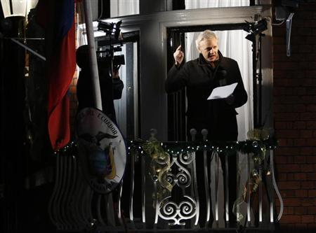 WikiLeaks founder Julian Assange gestures from the balcony of Ecuador's Embassy as he makes a speech, in central London December 20, 2012. REUTERS/Luke MacGregor/Files