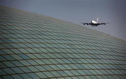 An Emirates airlines Airbus A380 comes in for landing over the roof of the Beijing Capital International Airport's train station March 6, 2012. REUTERS/David Gray