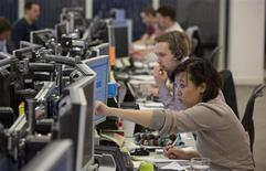 Traders react on the IG Group trading floor in London March 18, 2013. REUTERS/Neil Hall