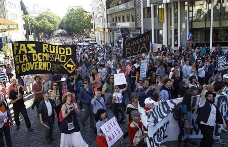 Demonstrators shout slogans during a rally against austerity measures organised by ''Screw the Troika'' movement in Lisbon June 1, 2013. REUTERS/Hugo Correia
