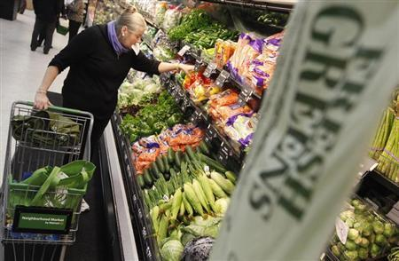 A shopper looks through the produce section in a newly opened Walmart Neighborhood Market in Chicago, September 21, 2011. REUTERS/Jim Young