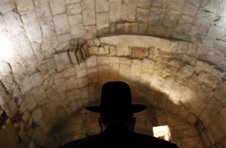 Shmuel Rabinovitch, Rabbi of the Western Wall, escorts members of the media during a tour of the tunnels under the Western Wall in Jerusalem's Old City October 22, 2009. REUTERS/Darren Whiteside