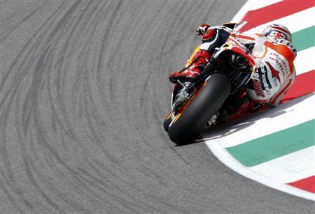 Honda MotoGP rider Marc Marquez of Spain takes a curve during the fourth practice session of the Italian Grand Prix in Mugello circuit, central Italy, June 1, 2013. REUTERS/Max Rossi