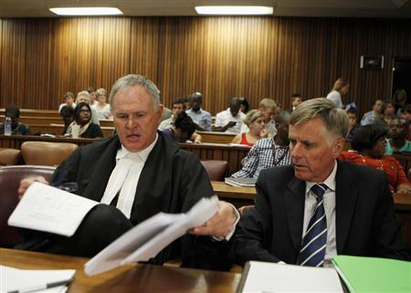Oscar Pistorius's lawyers Barry Roux (L) and Brian Webber prepare documents before the start of the application to appeal some of his bail conditions at a Pretoria court in Pretoria March 28, 2013. REUTERS/Siphiwe Sibeko