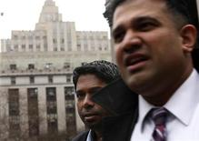 Rengan Rajaratnam, (L) the younger brother of imprisoned hedge fund manager Raj Rajaratnam, departs Manhattan Federal Court with his lawyer Vinoo Varghese (R) in New York, March 25, 2013. REUTERS/Brendan McDermid
